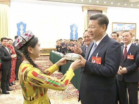 Си Цзиньпинь встречается с делегацией Синьцзян-Уйгурского автономного района в здании Всекитайского собрания народных представителей, Пекин.-1