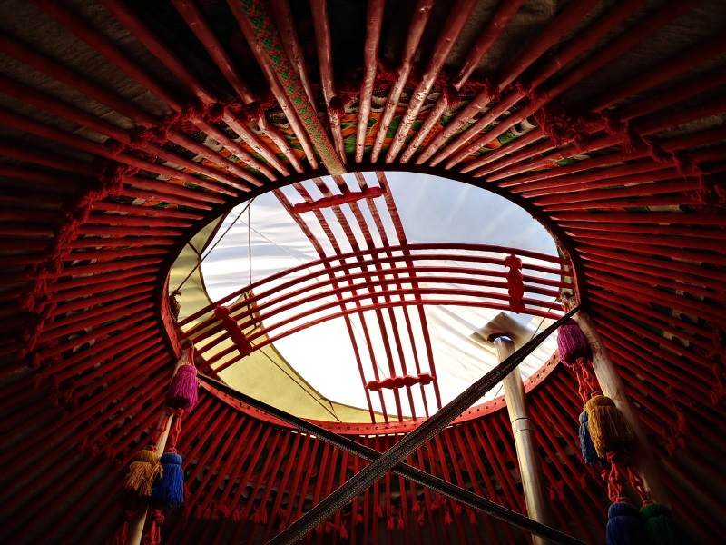 a-yurt-by-Lake-Issyk-Kul.-The-design-at-the-top-is-featured-in-the-Kyrgyz-national-flag.-e1576818096731